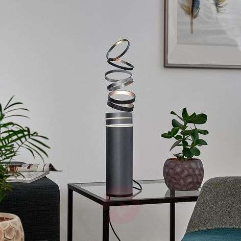 Decompose playful designer table lamp