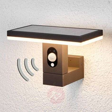 Linear solar wall light Josa with motion detector