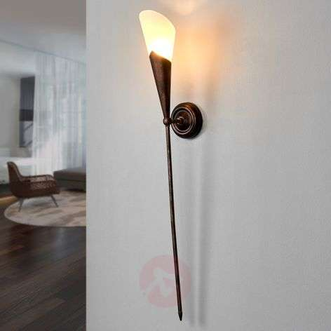 Rustic gothic wall torch in rust brown