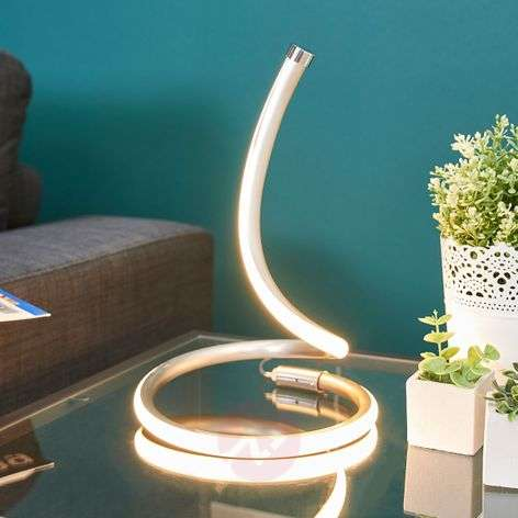 Sena LED table lamp with curved design